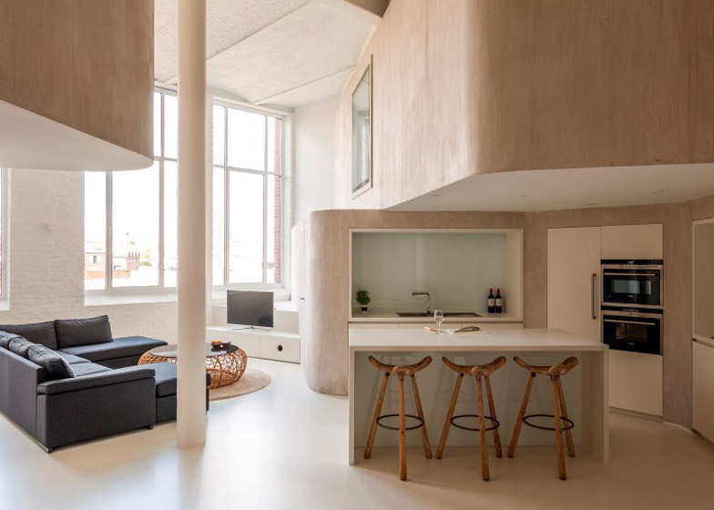 Graux & Baeyens uses curved walls to convert a factory loft into a family home 01