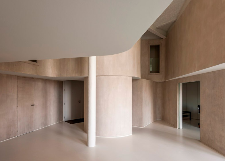 Graux & Baeyens uses curved walls to convert a factory loft into a family home 02